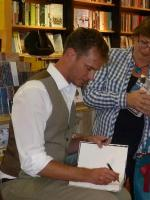 Jason Hewitt signing books in Browsers